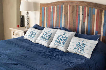 Mockup of Four Pillows Lying Over a Rustic Bed 23566