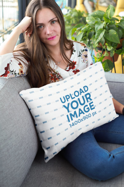 Pillow Mockup of a Girl Sitting on a Sofa 23609