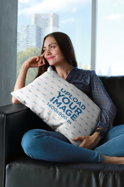 Pillow Mockup of a Happy Woman Sitting on Black Leather Couch 23614