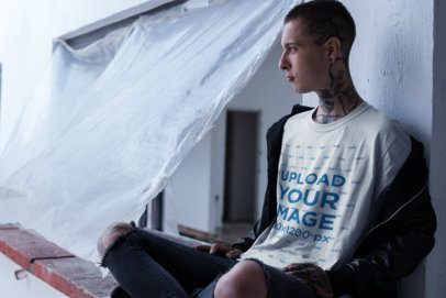 T-Shirt Mockup of a Punk Man with Tattoos at the Construction Site 23431