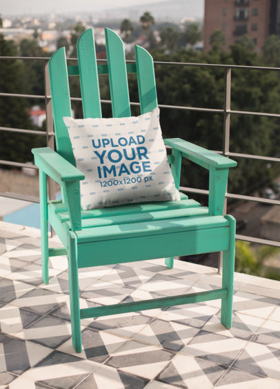 Mockup of a Pillow Lying On a Rustic Blue Chair 23558