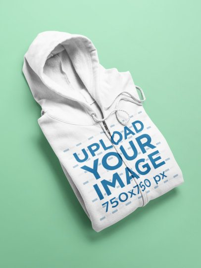 Flat Lay Mockup of an Angled Full Zip Hoodie Over a Surface 24208