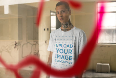 Tee Mockup of a Punk Man With Tattoos Behind a Graffiti on a Window 23460