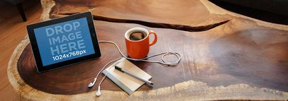 Tablet Mockup Featuring an iPad on top of a Wooden Coffee Table a4914