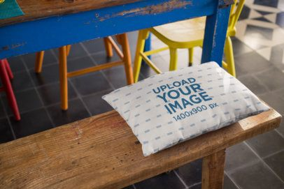 Mockup of a Rectangular Pillow Lying on a Wooden Bench 23568