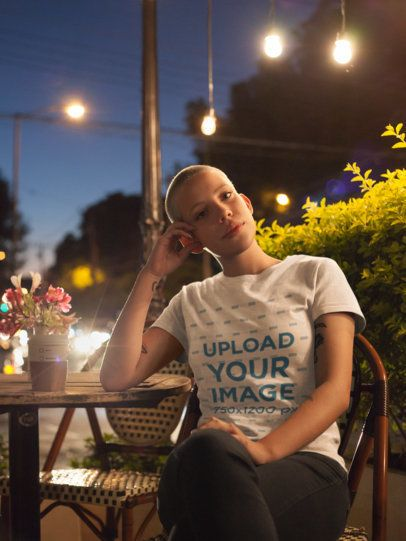 T-Shirt Mockup of an Alternative Girl Sitting in Coffee Shop At Night 18126