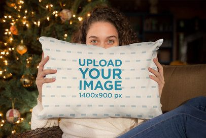 Pillow Mockup of a Beautiful Girl Holding a Pillow with a Christmas Background 23499