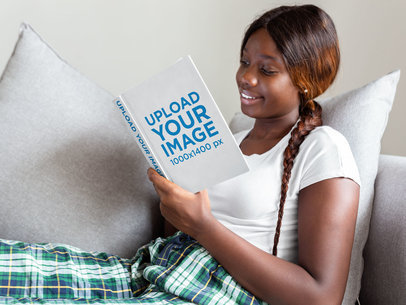 Book Mockup of a Smiling Woman Reading on the Couch 23694