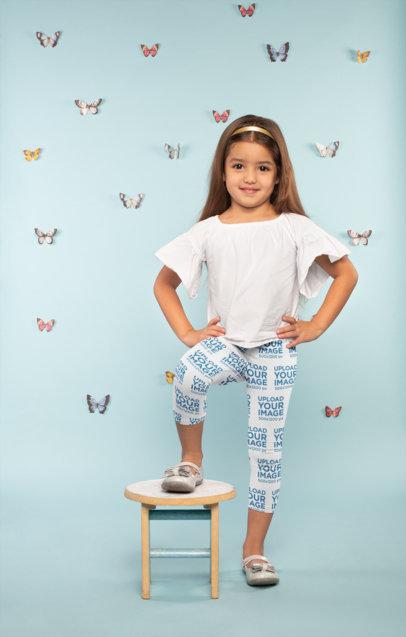Mockup of a Cute Little Girl Wearing Leggings Surrounded by Butterflies 23908