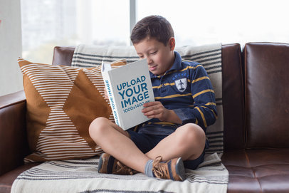 Mockup of an Attentive Young Boy Reading a Book 23719
