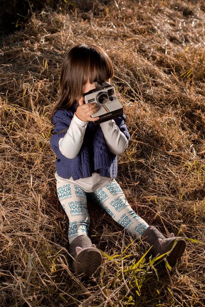 Legging Mockup of a Little Girl Playing with a Polaroid 23937