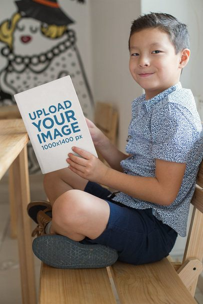 Book Mockup of a Little Boy Reading and Smiling 23726