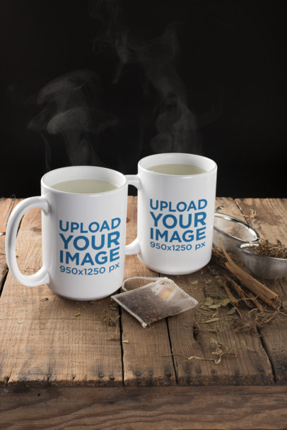 Mockup of Two Mugs with Steaming Water Surrounded by Tea Leaves 23902