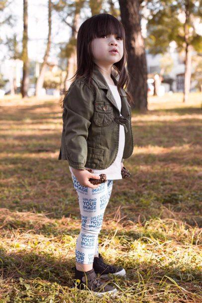 Mockup of a Little Girl Wearing Leggings in a Park 23929