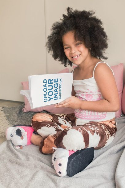 Mockup of a Beautiful Little Girl with an Afro Reading a Book in Bed 23703