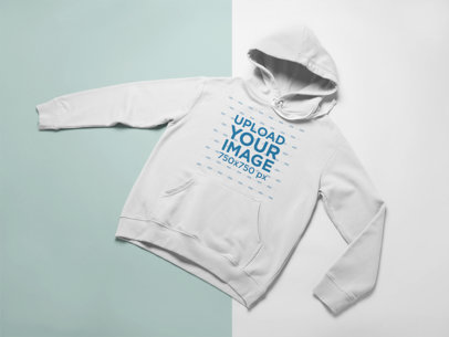 Flat Lay Mockup of a Hoodie Displayed Over a Duo Colored Surface 24229