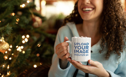 Mockup of a Smiling Woman Holding a Mug with Hot Chocolate and Marshmallows 23497