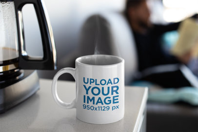 Mockup of a Coffee Mug Next to a Coffee Machine 24020