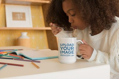 Mug Mockup of a Little Girl Drinking Tea with a Spoon 23906