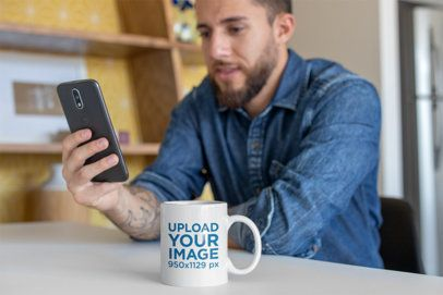 Mug Mockup Featuring a Tattooed Man Checking His Messages 24025
