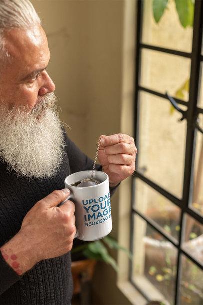 Mug Mockup of a Bearded Senior Man Drinking Tea 23979