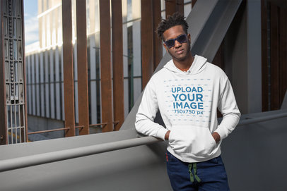 Hoodie Mockup Featuring a Man Standing on a City Structure 24314