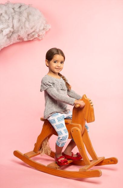 Leggings Mockup Featuring a Little Girl Sitting on a Rocking Horse 23912