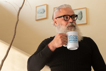 Mug Mockup of a Bearded Senior Having Tea at Home 23994
