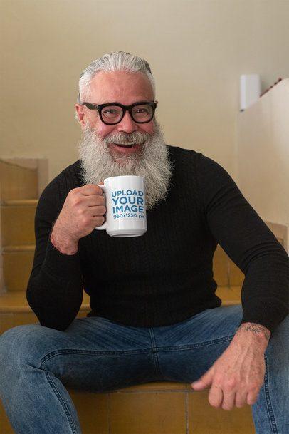 Mug Mockup of a Bearded Senior Man Having Tea in the Stairs 24002