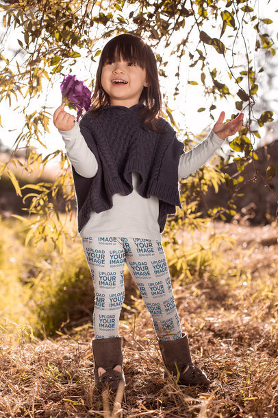 Mockup of a Cute Girl Wearing Leggings Holding a Flower 23935