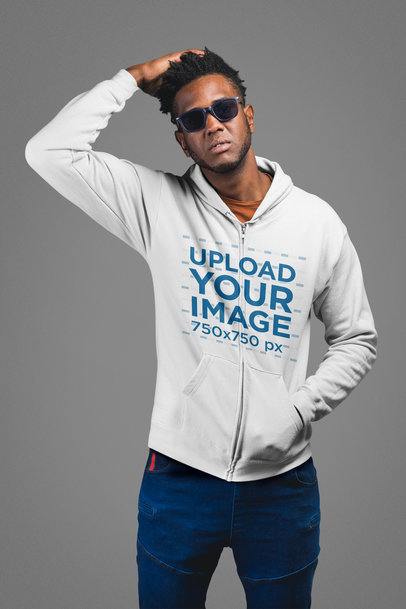 Mockup of a Man Wearing a Full Zip Hoodie in a Studio 24327
