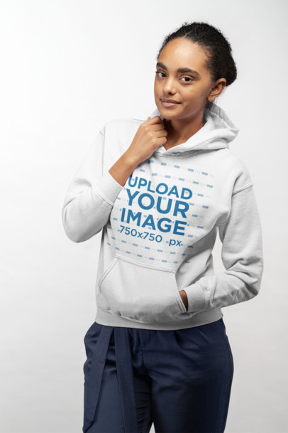 Mockup of a Woman Wearing a Pullover Hoodie in a Studio 24292