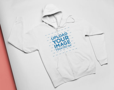 Flat Lay Mockup of a Full Zip Hoodie on Colored Cardboard 24370