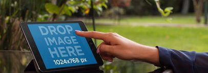 Tablet Mockup Featuring a Woman Using an iPad in her Backyard a5183wide