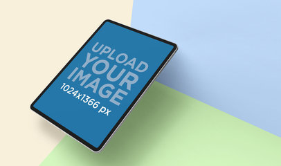 iPad Portrait Mockup Featuring a Tri-Color Surface 24466