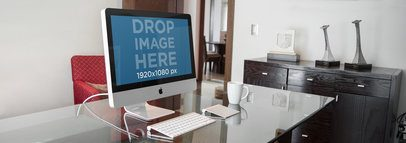 iMac Sitting on Top of a Glass Desk at a Home Office a4955