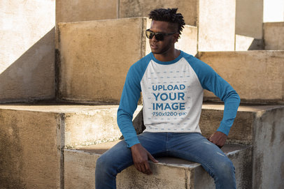 Mockup of a Cool Man Wearing a Raglan Tee Sitting on Large Stone Blocks 24106