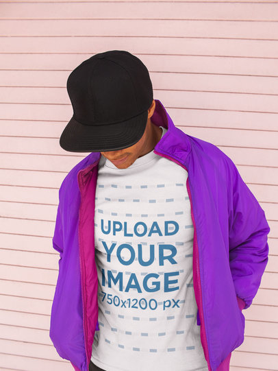 T-Shirt Mockup of a Cool Man with a Hat and a Retro Jacket 24726