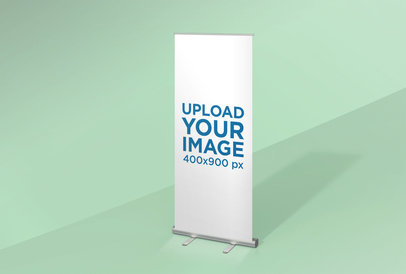 Mockup of a Roll-Up Banner Standing in a Space with One Color 24511