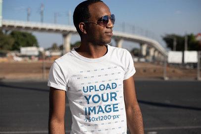 T-Shirt Mockup of a Man Looking at the Horizon 24064