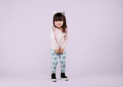 Leggings Mockup of a Little Girl Standing in a Studio Set 23926
