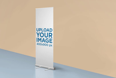 Mockup of a Roll-Up Banner Standing in a Room with Two Colors 24513