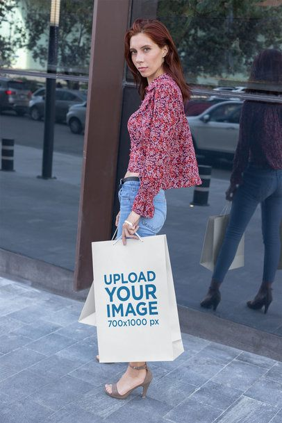 Mockup of a Tall Woman Walking with Her Large Gift Bag 24052