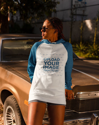 Raglan Hoodie Mockup Featuring a Woman Leaning on a Vintage Car 24152
