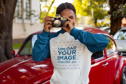 Raglan Hoodie Mockup of a Woman Taking a Picture with an Old Camera 24160