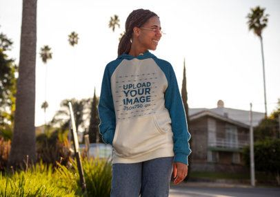 Mockup of a Woman Wearing a Heathered Raglan Hoodie Outside 24168