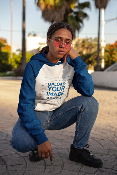 Raglan Hoodie Mockup Featuring a Cool Woman Wearing Tinted Sunglasses 24170
