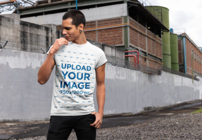Mockup of a Man Wearing a T-Shirt in an Industrial Area 24524