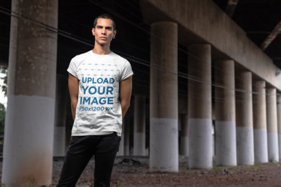 T-Shirt Mockup of a Serious Man Standing Under an Overpass Bridge 24533