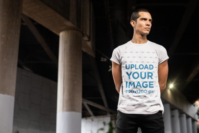 T-Shirt Mockup Featuring a Man Under a Bridge 24534